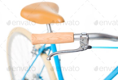 Stylish womens blue bicycle isolated on white