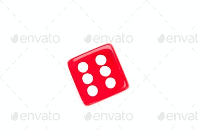 Dice designating a number six against a white background