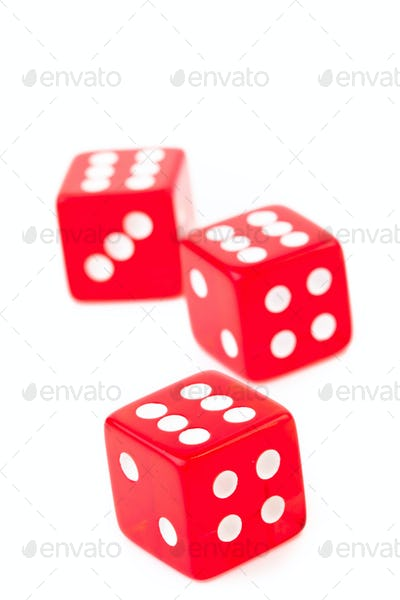 Three dices against a white background