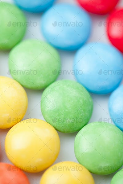 Chocolate sweetmeat multicolored against a white background